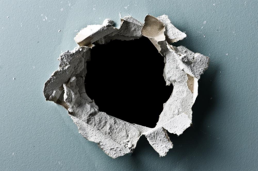sonhar com buraco na parede
