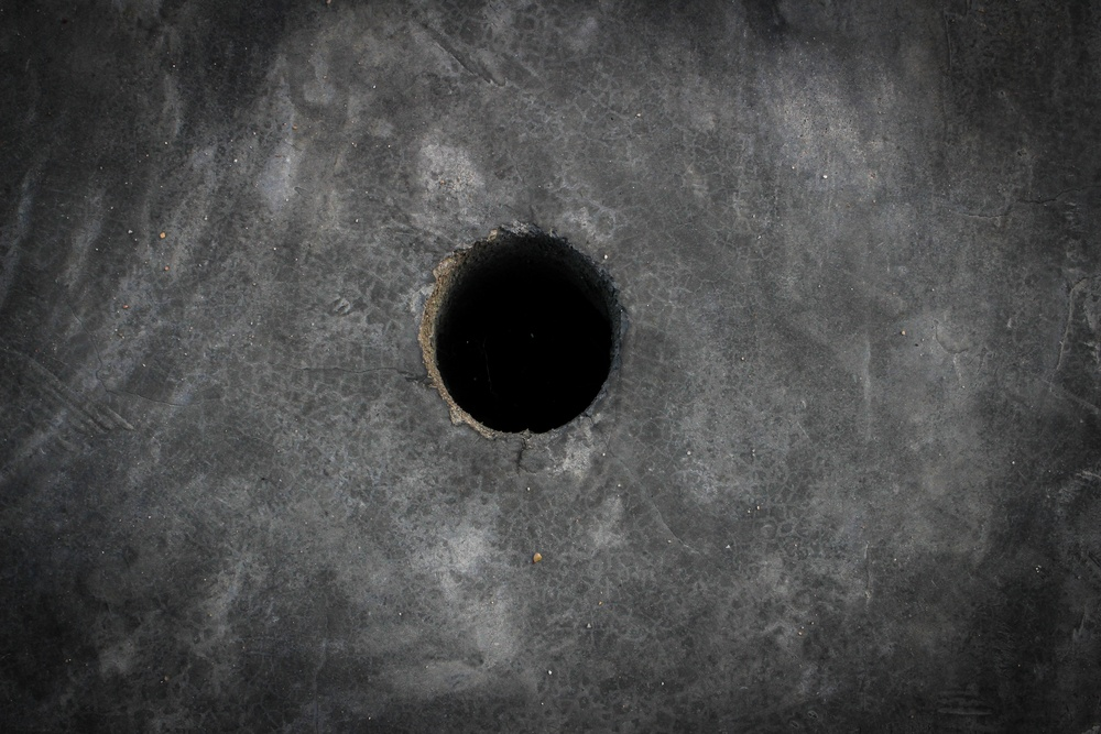sonhar com buraco no chão